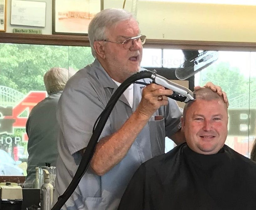 Roger Eckart cut the hair of Clark County Sheriff Jamey Noel in September 2018 at the Big 4 Barbershop in Jeffersonville, Indiana.