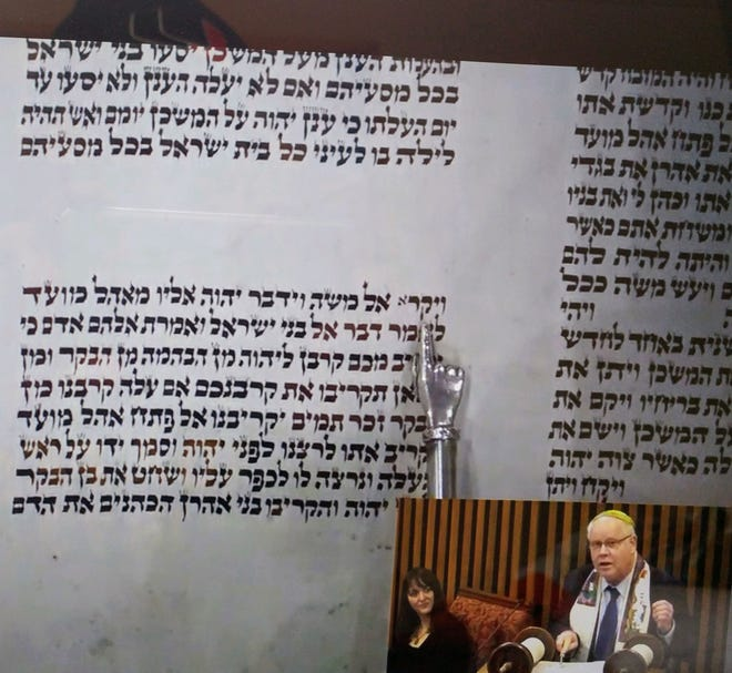 Rabbi David Ariel-Joel of The Temple reads Hebrew from the Torah in a recent service via Zoom. The synagogue has shifted to online services, including a virtual Passover, amid COVID-19 and social distancing.
