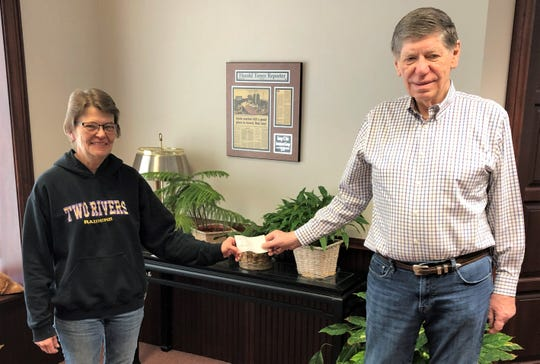 George Reis (right), president of the endowment fund, recently presented a check to Lynn Skarvan (left), representing TREP.These donations were able to be made by the efforts of the board of directors of the endowment fund.
