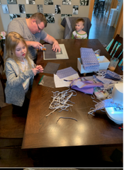 Chris Hiner and his daughter and son help make masks during the coronavirus pandemic. Wife Amy Hiner is making masks too.