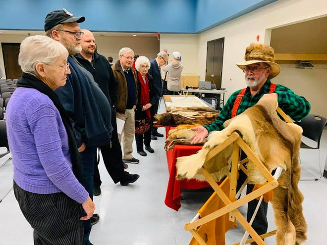 Richard Cooper, right, performs a first-person portrayal of Daniel Cooper, an 1820s era Marion County farmer, trapper, and tanner. Cooper presented his collection of Marion County native animal furs during the first Marion 200 Speaker Series event in January.