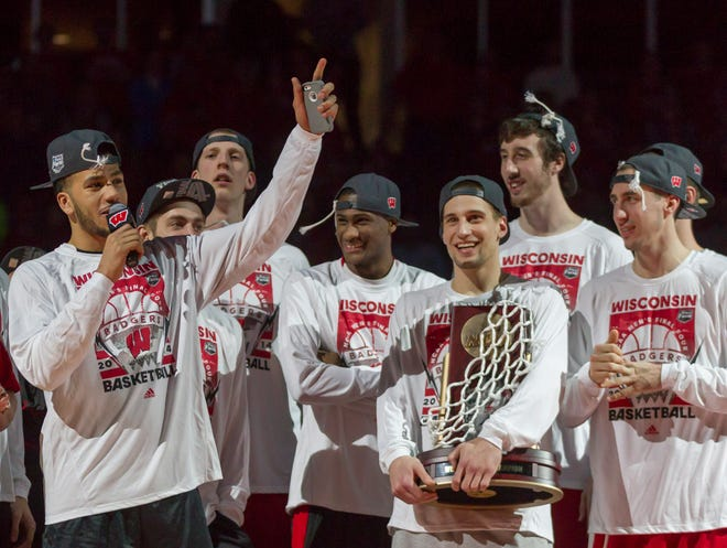 Wisconsin players acknowledges the crowd at the Kohl Center during a rally March 30, 2014, welcoming the team home from a victory that sent the Badgers to the Final Four.