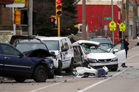 The wreckage of multiple cars including a U.S. Postal vehicle are seen on Friday, April 3, 2020, near the intersection of North 51st and West Center streets where a woman died of her injuries.