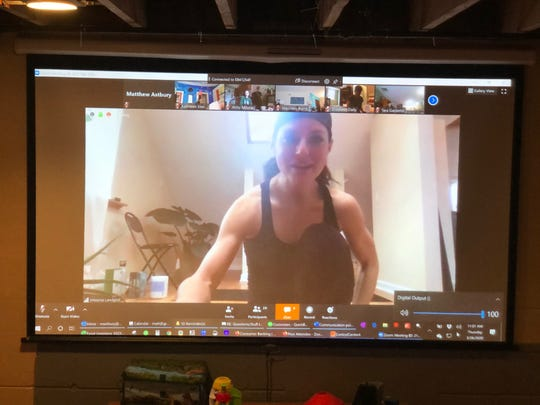 MelanieLandgraf sends out a Zoom link to all of her Tosa Yoga participants, and then mutes their speakers while she teachers the course.