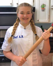 A.B. Perk, a 4-H'er in East Baton Rouge Parish, works to create a recipe as it's shown on Facebook Live. Perk is a member of the 4-H cookery project and is her school's cooking club president. Louisiana 4-H continues to maintain connections with the members in their club.