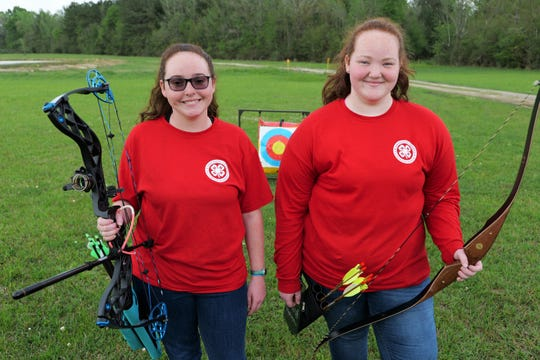 Sisters Jennifer, left, and Heather Kyzar, East Baton Rouge Parish 4-H'ers, continue practicing archery during weeks when the state has been in lockdown due to the coronavirus. Louisiana 4-H continues to maintain connections with the members in their club.