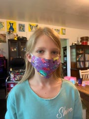 West Feliciana Parish 4-H'er Audrey Reinhardt shows one of the face masks she made for medical workers amid a shortage of personal protective equipment. Audrey is a member of the Sewing Project Club, carrying on the tradition of girls 4-H sewing clubs from the early 1900s. Louisiana 4-H continues to maintain connections with the members in their club.