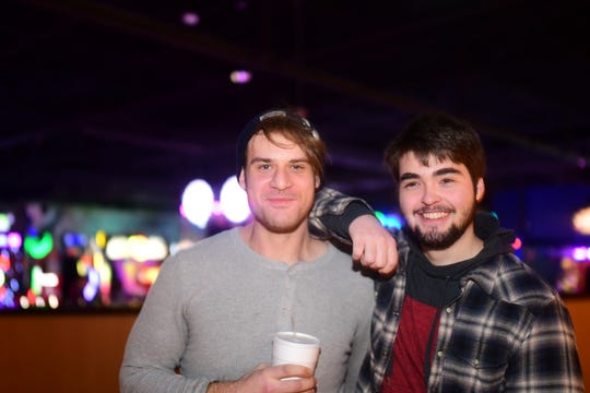 Clay Cronic, left, and his friend Matthew Gabriel during a recent bowling outing
