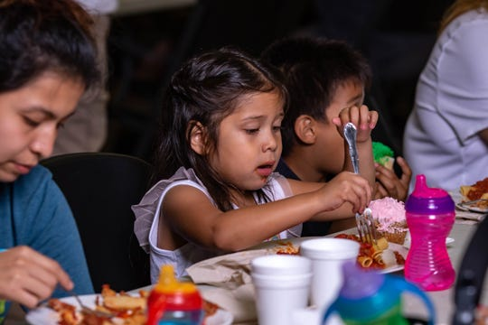 A family enjoys a meal at the St. Matthew's House Campbell Lodge. Single women with young children represent the fastest growing subset of the homeless population.