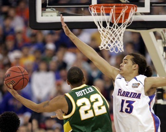 Florida's Joakim Noah (13) pressures George Mason's Lamar Butler (22) during the first half of their Final Four semifinal basketball game in Indianapolis, Saturday, April 1, 2006.