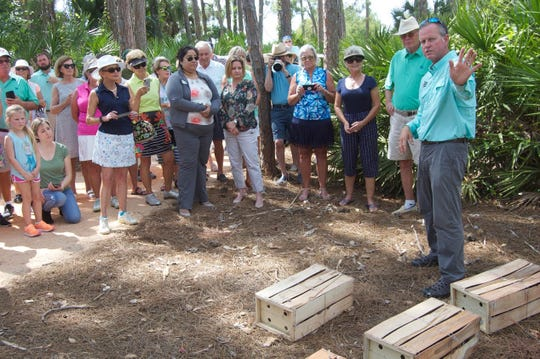Quail Creek Country Club members, residents and staff, gather to see the reintroduction of bobwhite quail into what was once their native habitat as Brian Beckner, owner of Native Bird Boxes, leads to the process on Tuesday, March 17, 2020.