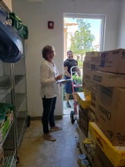 A food delivery arrives at the Naples Senior Center food pantry.