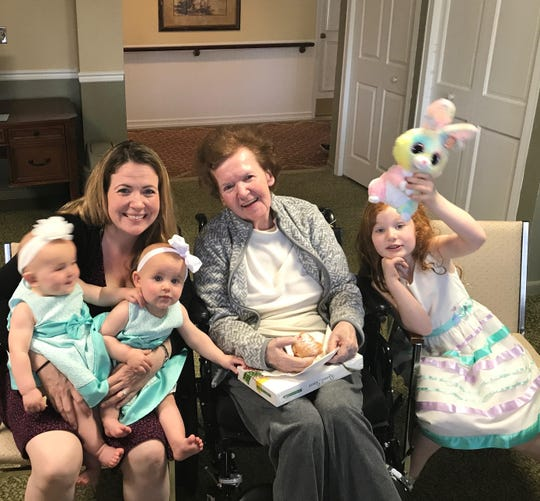 Lona Erwin at Family of Care Nursing Home with her daughter Alix Handy and grandchildren.