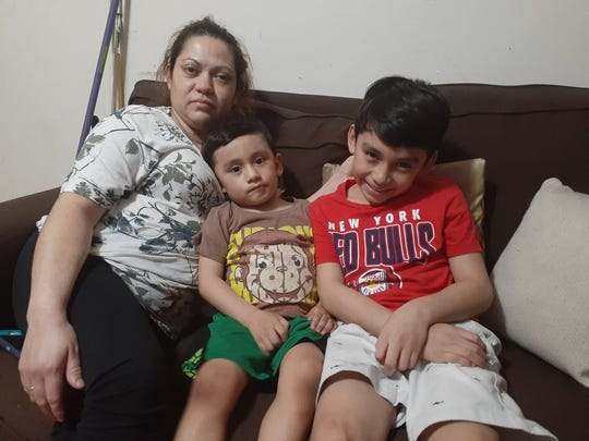 Geisel Gebara of Kearny sits next to her two sons. Gebara and her partner, Javier Martinez, have not been able to work since New Jersey began statewide lockdown of non-essential businesses to stop the spread of COVID-19.