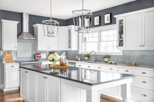 Kitchen cabinet doors constructed of laminate material, such as the Satin White Kershaw Style cabinets and island above, are attractive and, like solid wood, a popular choice for kitchen remodels.