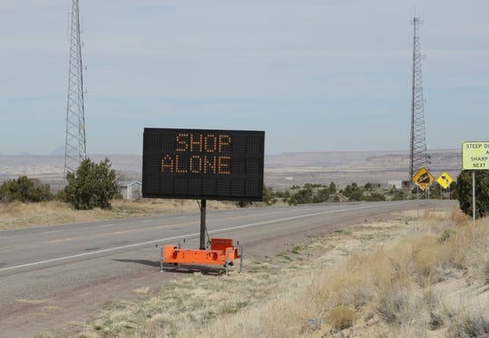 The New Mexico Department of Transportation is using electronic message boards to advise the public to shop alone to reduce the spread of COVID-19. A message board is situated on New Mexico Highway 371 south of Farmington.