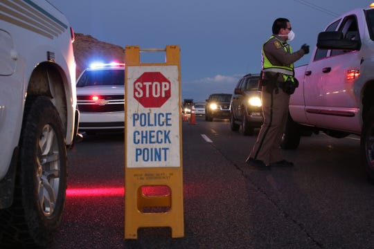 Navajo police officers from the Shiprock District conduct a checkpoint on April 1 to remind the public about the nightly curfew on the Navajo Nation.