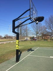 A basket at Canton Township's Griffin Park is shuttered.