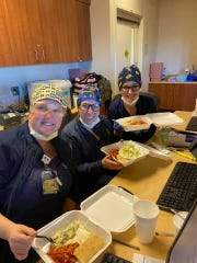 Nurses at University of Michigan's Mott Hospital enjoy meals prepared by Rose's restaurant in Canton Township. The delivery of the meals was orchestrated by Feeding the Front Lines.