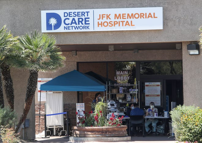 Medical workers work outside of the main lobby at JFK Memorial Hospital in Indio, April 3, 2020.