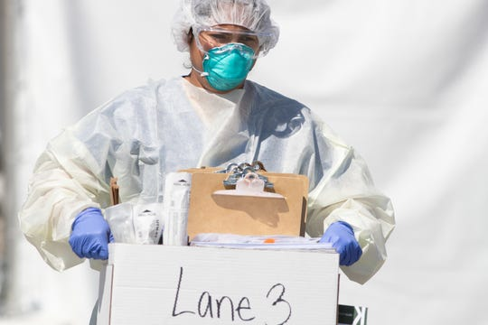 Health care workers and Riverside County employees conduct COVID-19 testing at the Riverside County Fairgrounds in Indio, Calif., on Thursday, April 2, 2020. Riverside County Health System will continue testing at the fairgrounds by appointment Tuesdays through Saturdays until further notice.