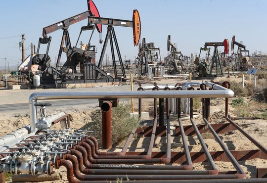 Oil rigs and pipeline infrastructure pump oil and gases in Kern County, California, February 20, 2020.