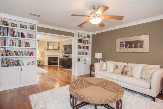 A formal living room is oriented at the front of the home.