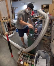Brandon Pruner with Ritche Wood Bats works on an order Friday.