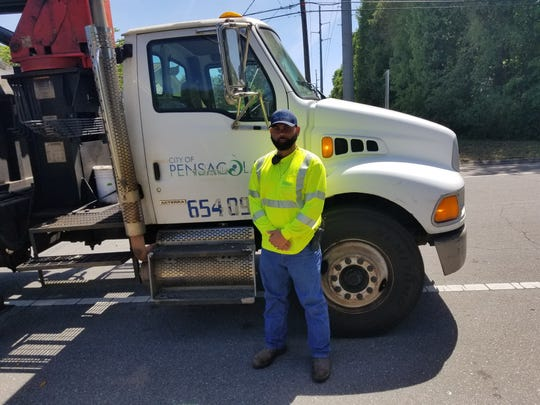 Ronald Booker, an employee with the city of Pensacola's sanitation department, stopped his vehicle to rescue a woman that was slumped out of the driver's side door of her vehicle and bleeding onto her driveway Wednesday morning.