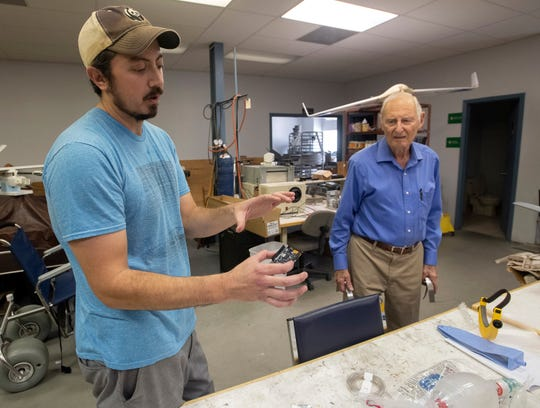 Eric Becker consults Friday with John Bray on a ventilator design to be built by Vertec Inc. The Pensacola-based manufacturing and industrial design company is doing its part to help combat the COVID-19 pandemic.