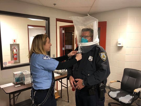 AREMS EMT Rhianna Zaney helps conduct a fit testing for a Reading Township police officer in March.