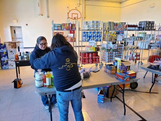 Volunteers at the Tuba City Juvenile Corrections facility sterilizing food and packaging it in food baskets for distribution to elders in the Chilchinbeto community through the Navajo Health Command Operations Center.