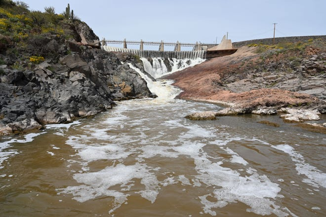 Water spills over Horseshoe Dam on the Verde River northeast of Phoenix in April 2020. The lake is filling with sediment, leaving less capacity to capture the water metro Phoenix needs.