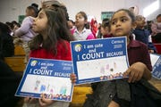 Paloma Solis, 6, (left) and Rita Harris, 5, both kindergartners, listen during an assembly about the 2020 U.S. census at Pueblo del Sol Elementary in Phoenix on March 4, 2020.