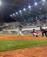 Former Vassar College baseball star Bryan Rubin gets a single during an exhibition game in Antofagasta, Chile on March 14.