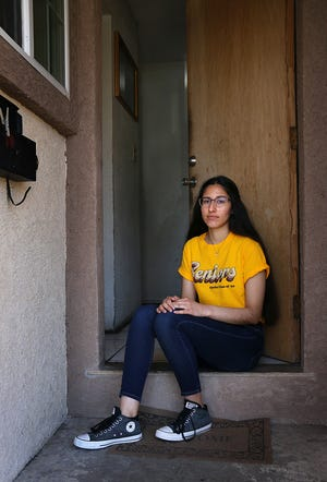 Sparks High School senior Susy Meza poses for a portrait in the front doorway of her home on April 3, 2020.