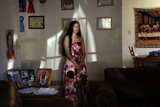 Sparks High School senior Susy Meza poses for a portrait while wearing her junior prom dress from last year in her home on April 3, 2020. Meza, along with all high school seniors, will not be able to participate in a senior prom this year.