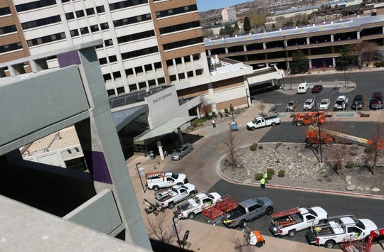 Work vehicles are seen at the Mill St. parking garage at Renown Regional Medical Center in Reno on April 3, 2020.