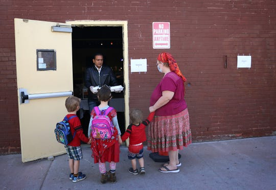 Owner Bishan Singh passes out free meals at his restaurant India Kabab & Curry in Reno on April 3, 2020.