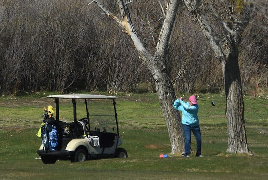 A golfer takes advantage of a beautiful morning at Washoe County Golf Course in Reno on April 2, 2020.