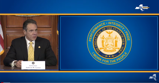 New York Gov. Andrew Cuomo unveils the state's newly update seal during his daily coronavirus briefing on Friday, April 3, 2020.