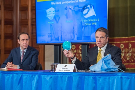 Gov. Andrew Cuomo on Friday, April 4, 2020, displayed the need for companies to make more masks and gowns for health-care workers during a briefing in the Red Room of the state Capitol.