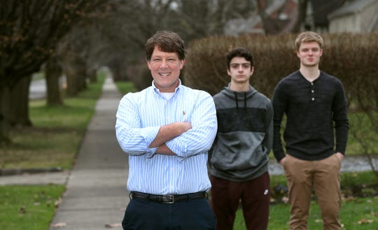 Psychiatric social worker Charles Iker addresses the impact of the coronavirus isolation on children and teens like his sons, Liam Field, 14 (middle) and Andrew Iker, 17.