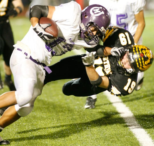 Mason High School's David Mora fights for yardage with Goldthwaite defender Josh Wilson in their regional final at Mustang Stadium in Marble Falls on Dec. 3, 2010. Goldthwaite won 27-26.
