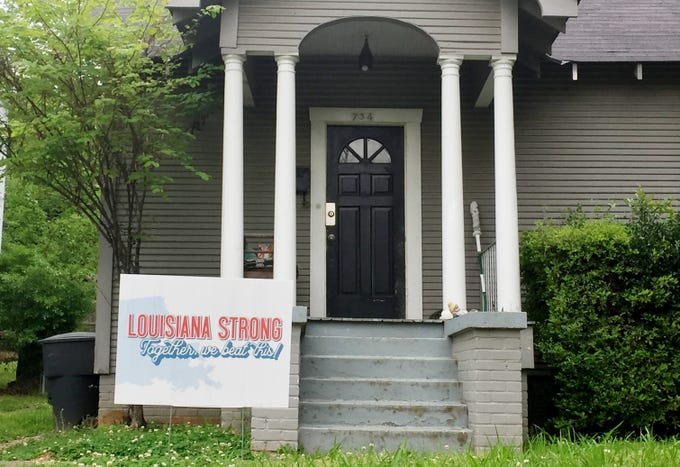 A home has a Louisiana Strong sign in their front yard.