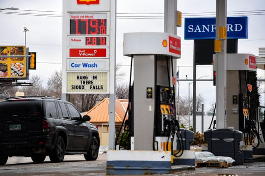 """A Shell gas station tells Sioux Falls residents to """"hang in there"""" on Friday, April 3, in Sioux Falls."""