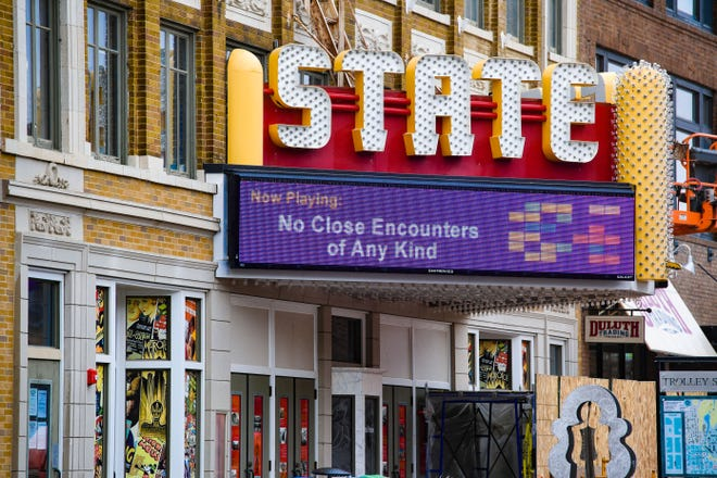 """The State Theater marquee displays a parody of the film title """"Close Encounters of the Third Kind"""" to encourage social distancing on Friday, April 3, in Sioux Falls."""