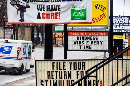 A salon marquee on Minnesota Avenue reminds people to be kind on Friday, April 3, in Sioux Falls.
