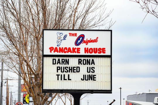 """The Original Pancake House's marquee announces a delay in their re-opening after the September tornadoes hit, using """"rona"""" to refer to the coronavirus on Friday, April 3, in Sioux Falls."""