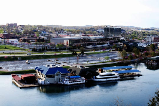 A Bass Pro Shops retail location and floating restaurant at Branson Landing were shown next to deserted parking lots in this April 2, 2020 News-Leader photo.